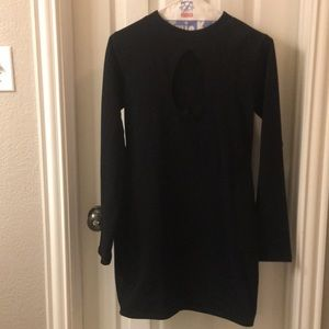 Black form fitting dress with cutout
